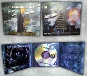 Image of CD &quot;New World Disorder&quot; Digipack Ltd. Ed. - signed copy