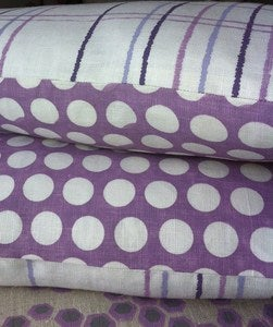 Image of reverse dotty/hand drawn check cushion