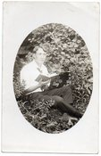 Image of DREAMY MAN READS A BOOK IN THE GRASS REAL PHOTO POSTCARD