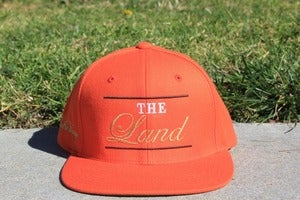 Image of The Land ( Orange Snapback )
