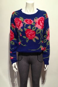 Image of knitted bed of roses jumper