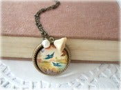 Image of Antique Brass Twin Bluebird Pendant with Cream Flower Necklace