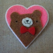 Image of brown pudgy bear + bowtie heart