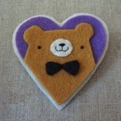 Image of mustard pudgy bear + bowtie heart