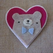 Image of grumpy pudgy bear + bowtie heart