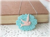 Image of Pink Swallow in Blue Frame Necklace
