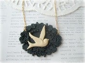 Image of Cream Swallow in Black Frame Necklace