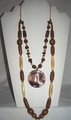 Image of Wood Beads Multi Strand Necklace with Shell Pendant Essence of Earth