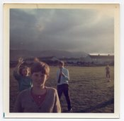 Image of KIDS IN A FIELD WEIRD SKY VINTAGE COLOR SNAPSHOT