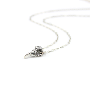 Image of Merla. Tiny Raven Skull Necklace