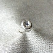 Image of sunken ring with sapphire