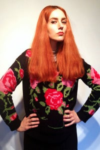 Image of knitted black bed of roses jumper