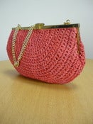 Image of red raffia straw handbag