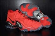 "Image of Nike ""Quickstrike Red"" Zoom Turf"