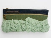 Image of a tough ruffles double zip clutch in forest + wintergreen