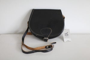 Image of 1970s small black saddle bag