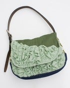Image of a large tough ruffles shoulder bag in pine + wintergreen