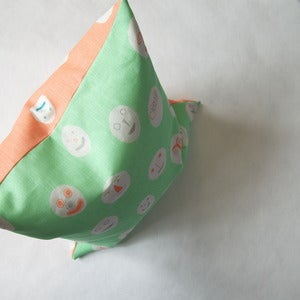 Image of Masks cushion - peppermint & coral