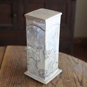 Image of Tall box with Greyhounds and rabbits in black and light blue